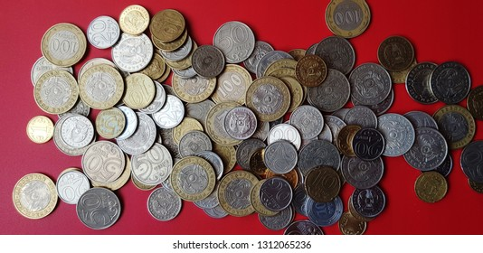 Tenge. Money. Kazakh coins on the red table top view.