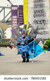 Tenggarong, Indonesia - October 10th, 2015: carnival with unique costumes on public roads within distance 4 km  and is held every year in east borneo indonesia