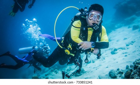 Tenggol, August 6, 2017- Scuba diver swims underwater during scuba diving at Tenggol Island, Malaysia.