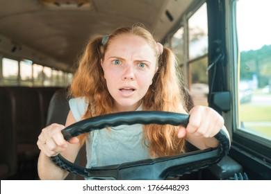Tennager drive schoolbus. Teen driver on School Bus