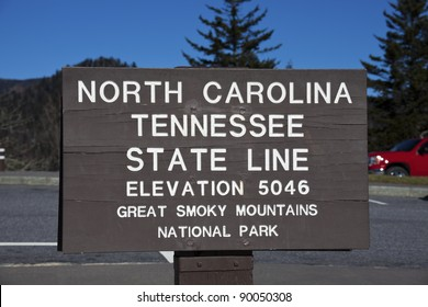 Tennessee - North Carolina state line. The sign in Smoky Mountains by Appalachian Trail.