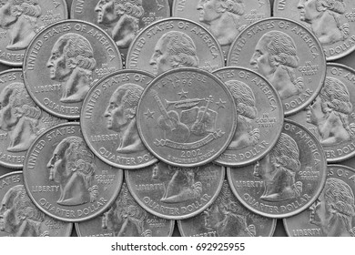 Tennessee State and coins of USA. Pile of the US quarter coins with George Washington and on the top a quarter of Tennessee State.