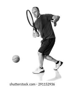 Tennis action shot. Forehand. Studio shot over white.