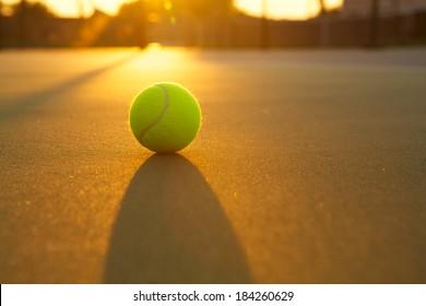 Tennis Ball Backlit by a Warm Sun