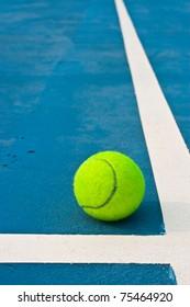 Tennis ball beside white line