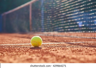 Tennis ball with blurred background.