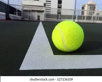 Tennis ball at a corner of hard court