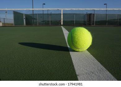 Tennis ball, court and net