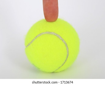 Tennis ball and a finger isolated on white, close-up, copy space, macro,