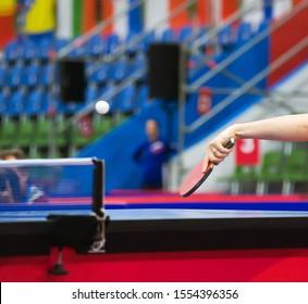 A tennis ball flies over a tennis table