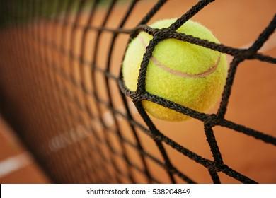 Tennis ball hitting the tennis net on tennis court. Failure concept
