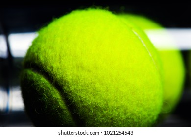 Tennis Ball isolated on black with dramatic lighting