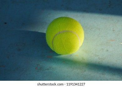 tennis ball isolated on blue background