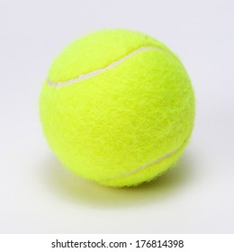 tennis ball isolated on a grey background