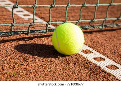 tennis ball with line and net on a sand court