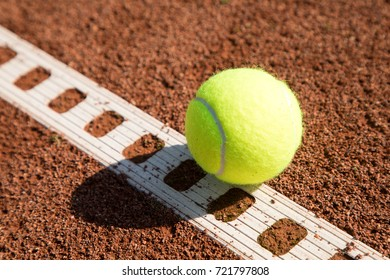 tennis ball with line on a sand court