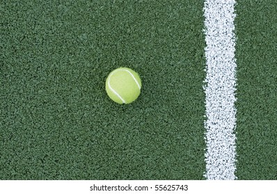 tennis ball lying on a court