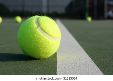Tennis ball near the court line