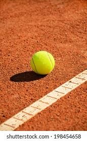 tennis ball near markup. diagonal vertical format