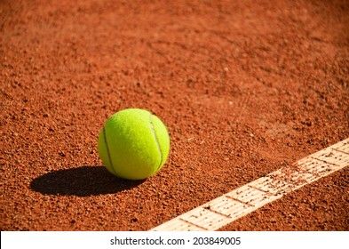 tennis ball near markup diagonal horizontal format