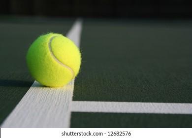 Tennis ball near the midcourt line