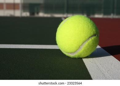 Tennis ball near the service line