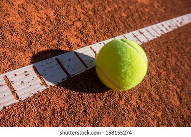 tennis ball next to the line