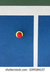 Tennis Ball on Blue Court ,Top View