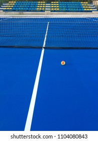 Tennis Ball on Blue Hard Court