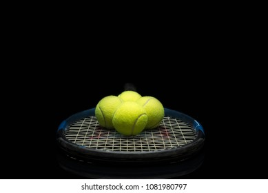 Tennis ball on a blue racket, center view