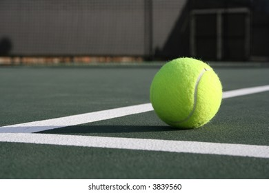 Tennis ball on the corner of the court lines