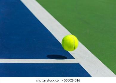 Tennis ball on the corner of court