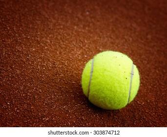 Tennis ball on the court closeup