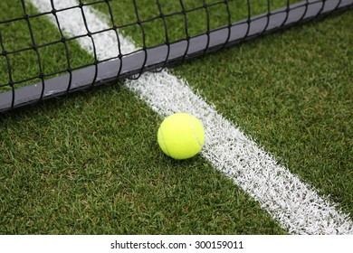 Tennis ball on grass tennis court