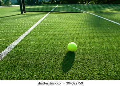 tennis ball on tennis grass court good for background