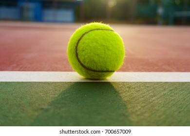 tennis ball ,tennis ball on tennis grass court with sunlight.