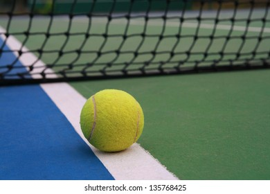 ,tennis ball on green blue court and net in sport competition background, sport club concept