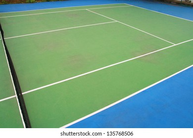 tennis ball on green blue court and net, sport competition background, sport club