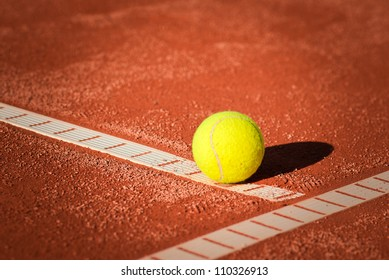 tennis ball on ground