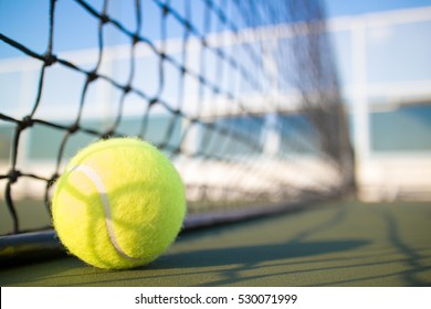 Tennis ball on hard court