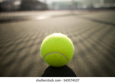 Tennis ball on hard court
