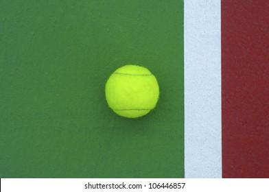 tennis  ball on line court