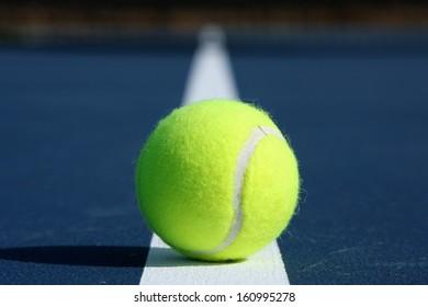 Tennis Ball on a Modern Blue Court