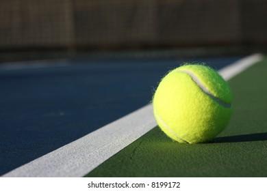 Tennis ball on a new court