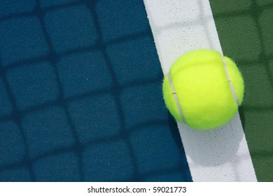 tennis ball on the out line of court