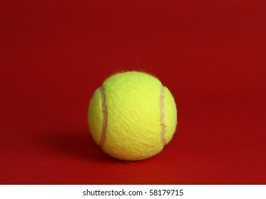 Tennis Ball on red background