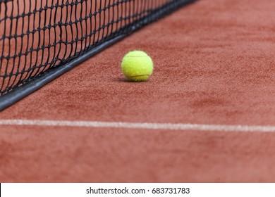 Tennis ball on a smashcourt tennis court