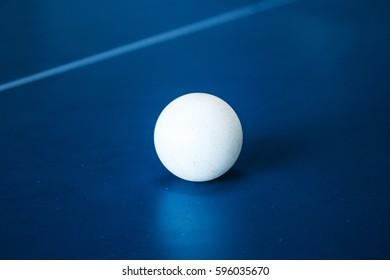 a tennis ball on a tennis table
