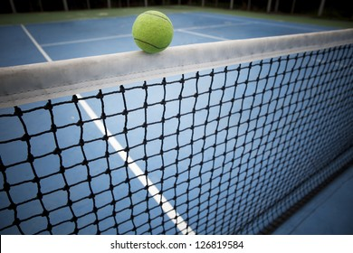 tennis ball over black net seam win or loose