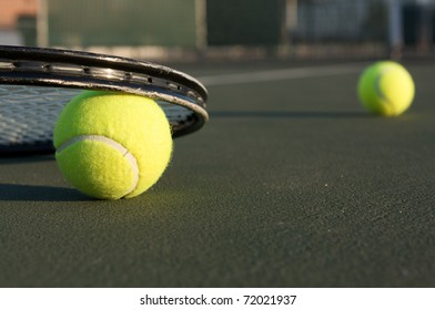 Tennis Ball and Racket with ball in distance